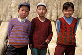 three girls stock photography | China, Gansu Province, Children and lambskins, Linxia, image id 4-117-2