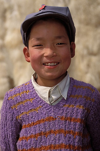 image 4-117-5 China, Gansu Province, Young boy and lambskins, Linxia