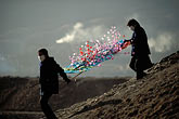 two people stock photography | China, Gansu Province, Paper flowers to honor the dead, Xiahe, image id 4-126-7