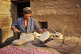 bake stock photography | China, Turpan, Baker preparing Uighur bread (nan), image id 4-155-11