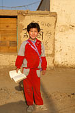 solo portrait stock photography | China, Turpan, Uighur child on way to school, image id 4-155-20