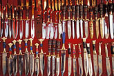 shopping street stock photography | China, Ur�mqi, Uighur daggers for sale at street stall, image id 4-169-35