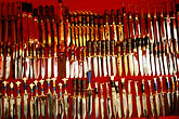sale stock photography | China, Ur�mqi, Uighur daggers for sale at street stall, image id 4-170-5