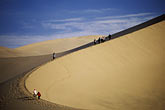 curved stock photography | China, Dunhuang, Climbing the Mingsha sand dunes , image id 4-387-27