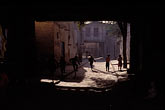 shade stock photography | China, Kashgar, Children playing in alleyway, image id 4-422-32