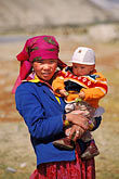 two people stock photography | China, Pamirs, Young Kirghiz girl and child, image id 4-438-91