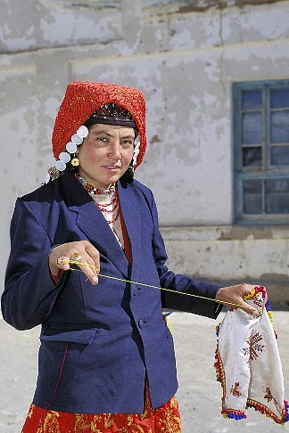 image 4-442-35 China, Pamirs, Tajik woman embroidering