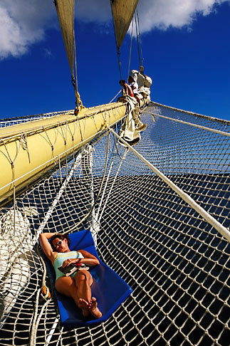 image 3-610-18 Caribbean Cruise, Royal Clipper, relaxing on the bowsprit net