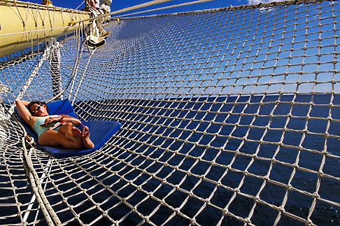 image 3-610-19 Caribbean Cruise, Royal Clipper, relaxing on the bowsprit net