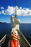 vertical stock photography | St. Vincent, Grenadines, Royal Clipper, relaxing on the bowsprit, image id 3-610-30