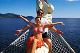 woman and man stock photography | St. Vincent, Grenadines, Royal Clipper, relaxing on the bowsprit, image id 3-610-33