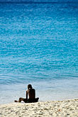 seated stock photography | Curac�ao, Knip Beach, young boy playing, image id 3-433-9