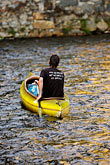 yellow river stock photography | Czech Republic, Cesky Krumlov, Canoeing on the Vlatava River, image id 4-960-1022