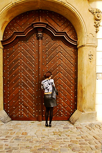 image 4-960-657 Czech Republic, Prague, Woman at doorway