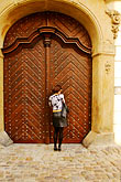 stand stock photography | Czech Republic, Prague, Woman at doorway, image id 4-960-657