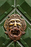 face stock photography | Czech Republic, Prague, Ornate door knocker, image id 4-960-6698
