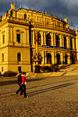 woman walking stock photography | Czech Republic, Prague, Rudolfinum concert hall, image id 4-960-6750