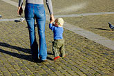 outdoor stock photography | Czech Republic, Ceske Budejovice, Woman and child crossing town square, image id 4-960-6944