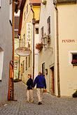 woman walking stock photography | Czech Republic, Cesky Krumlov, Village street scene, image id 4-960-7189