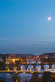 span stock photography | Czech Republic, Prague, Bridges on the River Vlatava in the moonlight, image id 4-960-7474