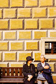 men and women stock photography | Czech Republic, Cesky Krumlov, Couple on bench at Krumlov Castle, image id 4-960-925
