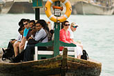 on the ferry stock photography | United Arab Emirates, Dubai, Passengers on Small Boat or Abra crossing Dubai Creek, image id 8-730-1475