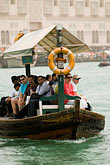 vertical stock photography | United Arab Emirates, Dubai, Passengers on Small Boat or Abra crossing Dubai Creek, image id 8-730-1477