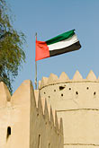 vertical stock photography | United Arab Emirates, Abu Dhabi, Emirates flag, Sultan Bin Zayed Fort, Al Ain, image id 8-730-1794
