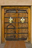 decorated door stock photography | United Arab Emirates, Dubai, Dubai Fort, Carved wooden doorway, image id 8-730-264