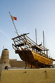 vertical stock photography | United Arab Emirates, Dubai, Dubai Fort and Museum, traditional Arab dhow sailing ship, image id 8-730-270