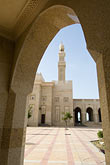 courtyard stock photography | United Arab Emirates, Dubai, Mosque archway and minaret, Jumeirah, image id 8-730-8999