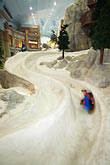 man stock photography | United Arab Emirates, Dubai, Ski Dubai, indoor toboggan run, image id 8-730-91