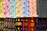 middle east stock photography | United Arab Emirates, Dubai, Colorful fabrics for sale in the Souq , image id 8-730-9142