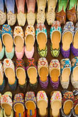 leatherwork stock photography | United Arab Emirates, Dubai, Colorful shoes for sale in the Souq , image id 8-730-9180
