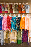 market stall stock photography | United Arab Emirates, Dubai, Dresses for sale in the Souq , image id 8-730-9182