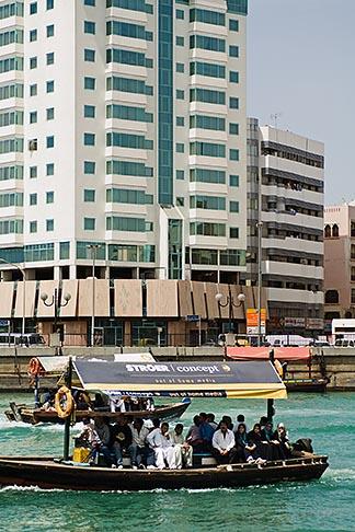 image 8-730-9305 United Arab Emirates, Dubai, Passengers on Small Boat or Abra crossing Dubai Creek
