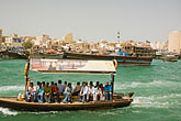 arab man stock photography | United Arab Emirates, Dubai, Passengers on Small Boat or Abra crossing Dubai Creek, image id 8-730-9321