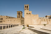 old quarter stock photography | United Arab Emirates, Dubai, Wind towers and courtyard, Bastakiya Quarter, restored historic site, image id 8-730-9341