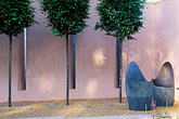 flower and wall stock photography | England, Chelsea Flower Show, Lladro Sensuality Garden, Chairs by Dennis Fairweather, and hornbeam trees, image id 3-753-87