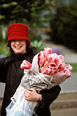 red flower stock photography | England, Chelsea Flower Show, Woman leaves the show with an armful of tulips, image id 3-757-11
