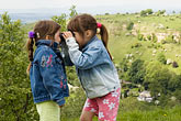 looking up stock photography | England, Gloucestershire, Two girls playing with binoculars, image id 4-900-2162