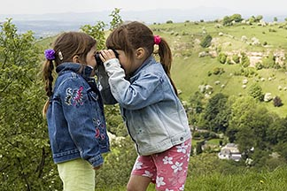 4-900-2162  stock photo of England, Gloucestershire, Two girls playing with binoculars