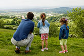 wonder stock photography | England, Gloucestershire, Family on hillside, image id 4-900-2165