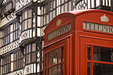telephone box stock photography | England, Chester, Telephone box and Tudor house, image id 7-690-7403