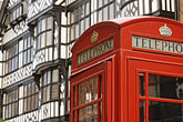 telephone box stock photography | England, Chester, Telephone box and Tudor house, image id 7-695-7403