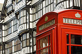 telephone box and tudor buildings stock photography | England, Chester, Telephone box and tudor buildings, image id 7-695-7405
