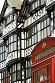 vertical stock photography | England, Chester, Telephone box and tudor buildings, image id 7-695-7410