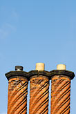 vertical stock photography | England, Three brick chimneys, image id 7-695-7502