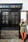 vertical stock photography | England, Chester, Man on phone outside pub, image id 7-695-9970