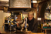 beer stock photography | England, Chester, Man pouring beer in pub, image id 7-695-9974